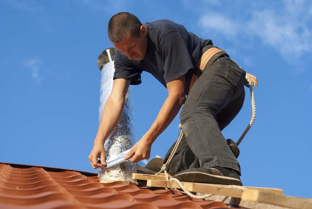 patch up chimney as a part of roof maintenance